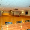 Spacious, attractive meeting Hall upstairs includes bar, stage, restroom, and dining space.